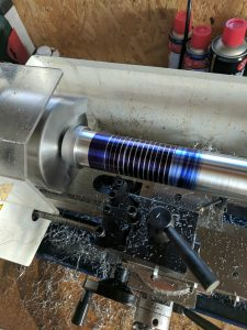 Adding some fine grooves into the hilt of the Lightsaber on the lathe.